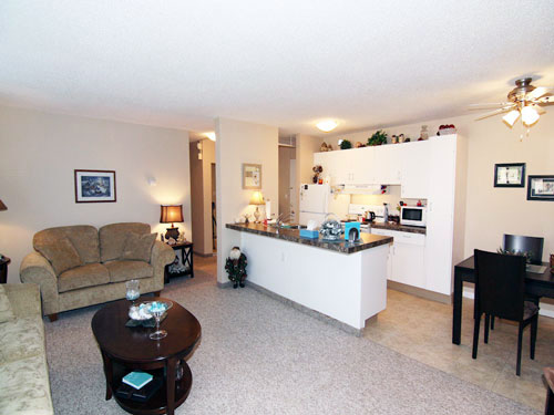 photo of kitchen and living room at Willow Estates, Red Deer, Alberta
